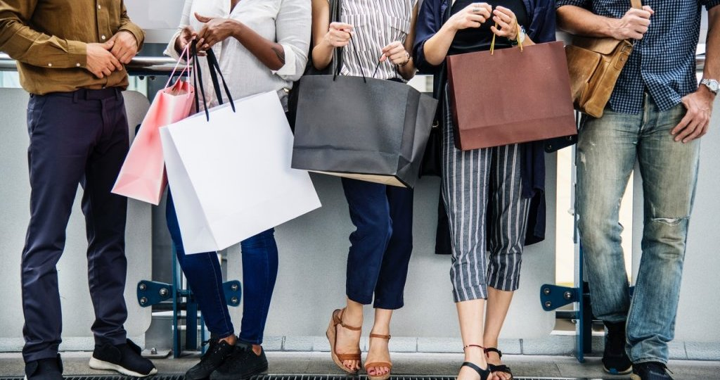 people standing with shopping bags